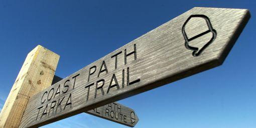 Coast path Tarke trail finger post